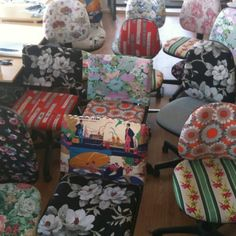 Retro covered office chairs. I like the idea but would use less clashing fabric options!