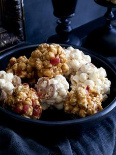 Sweet, gooey, salty and crunchy, this popcorn ball recipe is sure to satisfy both your sweet tooth <em>and</em> your salty tooth.