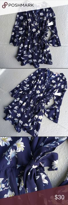 Blue Floral Romper with Tied Waist This is a gorgeous romper! 😍 It's dark blue with a floral pattern. It wraps and ties around the waist. Size small. Urban Outfitters Dresses