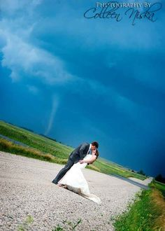This Couple's Wedding Pictures Were Photobombed By A Tornado And They Look Totally Badass