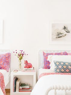 White and pink colors in kids room with two beds