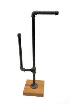Industrial toilet paper holder/stand made from unfinished iron pipe fittings with a natural gunmetal color. You can chose 3 different colors for the metal pipe