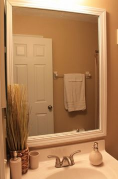 Really would like to do this in my bathroom. Framed Bathroom Mirror DIY