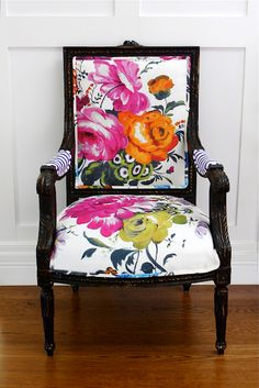 carved chair painted black wood with unique beautiful floral fabric