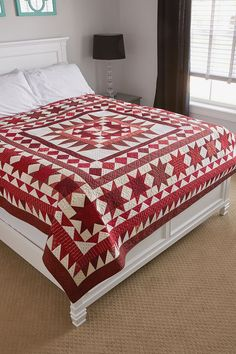 RED BETWEEN THE LINES quilt kit: An abundance of red and cream prints make up this bed-sized stunner. Stars, triangles, squares and borders are laid around its pinwheel center. Kit includes fabric from Marcus for quilt top and binding. Instructions are included.
