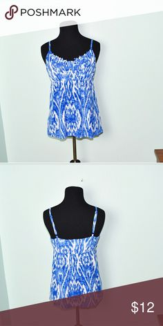 Gorgeous Blue & White Print Flowy Blouse In excellent condition! Very comfortable, lightweight, and stretchy! Buy 3 items and get 1 free plus 15% off your purchase total! Tops Blouses