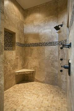 Master bath - example colors of warm tiles. Do not like dark border. Would like bench and cut out or shelf's for shower products