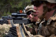 Marines fire a M240B machine gun during a military bilateral training engagement, July 9, 2014, at Camp des Garrigues, France. Marines with 3rd Battalion, 8th Marine Regiment, and Legionnaires from 2nd Foreign Infantry Regiment of France's 6th Light Armored Brigade trained together July 7-11 in a series of training events that ranged from foreign weapons familiarization, live fire ranges, ordinance familiarization and military operations in urban terrain.