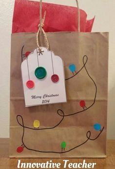 Here's a cute idea for Christmas gift bags! Draw a string on the bag and use paint to create the lights. (The lights are my son's thumb prints). For an added bonus, use green and red buttons on a gift tag.