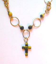 Brass necklace with yellow turquoise cross, beads.