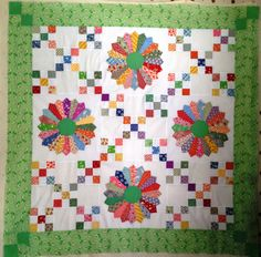 PAT QUILTZ TOO  These colorful 9 patches really livened up this dresden plate quilt