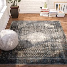 Dress up your floors in eye-catching style with this polypropylene area rug, crafted in Egypt. Its distressed details pair perfectly with antiqued figurines while its floral motif adds botanical charm to your decor. Lean into this piece's versatility by adding it to a chic boho living room alongside a Chesterfield sofa and matching suzani-print slipper chairs for a dynamic arrangement. Accent the arrangement with embroidered patchwork pillows for a touch of texture, then anchor the space ...