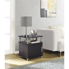 The Carson End Table (in multiple colors) will bring function and style to your living room. It features enough room for displaying lamps, picture frames and other decorative items. Its open shelf can also hold books, magazines and the remote, while the hidden compartment offers even more storage options. Coordinate this end table with cabinet with other pieces from the Carson collection for a pulled-together look. It is constructed of composite  >>> Check this awesome product by going to…