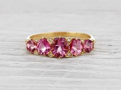 Vintage Victorian band made in 18k yellow gold and set with five old mine cut tourmalines weighing approximately 2.5 carats total. Circa 1880.