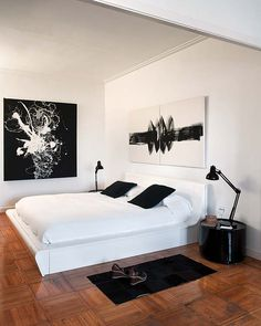 Abstract paintings on the walls of this minimalist bedroom. Black & white #minimalist #bedroom #furniture #minimalistspace