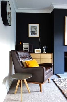 A bold off black feature wall gives this traditional space a real edge #myhomerocks