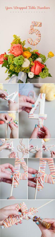 diy yarn wrapped table numbers for wedding table decoration ideas / http://www.deerpearlflowers.com/diy-wedding-table-number-tutorials-samples/6/