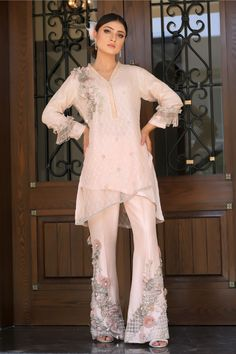 New Arrival Design 2019 Peach sequined embroidered double layered top with flower and pearl embroidery on neckline. Peach raw silk trousers with flower, pearl and accessories embroidery. Available to order as boot cut or straight trousers. Desi Wedding Dresses, New Arrival Dress, Desi Clothes, Asymmetrical Tops, Silk Organza, Green Silk, Fashion Sewing, Pakistani Dresses, Designer Dresses