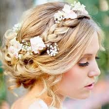 Bridesmaids hair options. Pinned loosely with a large braid and flowers.
