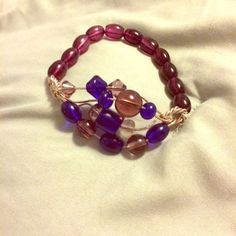 Handmade bracelet Blue & purple stone bracelet. Twisted wire front with stretch beaded back. Center beads move for those who like something tactile when nervous or searching for inspiration. Handmade!  Very unique item! Kiwi Kissed Designs Jewelry Bracelets