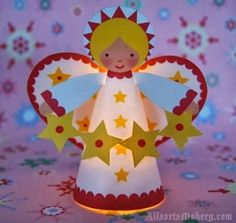 Starry Christmas Angel Paper Model - by Jenny / All Sorts  --   Leaving a bit of Halloween theme here is a cute Starry Christmas Angel Paper Model to decorate your home, created by designer Jenny B Harris, from All Sort website.