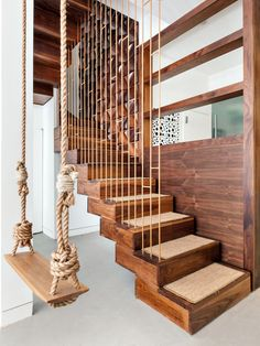 Plain white metal stairs were redone in a warm walnut. The client originally wanted a hanging daybed, but when this wasn't structurally possible, they opted for a cute oak swing - love an indoor swing! Wood Railings For Stairs, Wrought Iron Stair Railing, Stair Railing Design, Metal Stairs, Staircase Railings, Curved Staircase, Wooden Stairs, Stair Case Railing Ideas, Indoor Stair Railing
