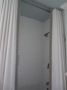 tutorial on making shower curtain out of sheets then adding trim.  especially like having these hang high as dummy panels and then have liner behind on regular shower curtain rings.