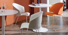 Dream white designer cafe tables with orange Grace cafe chairs