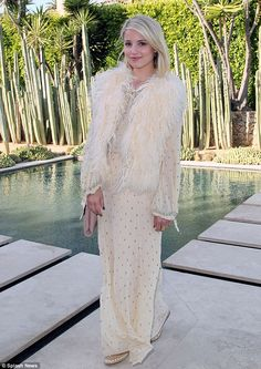 Dreamy: Dianna Agron looked angelic in white while attending a wildlife fundraising event on Saturday