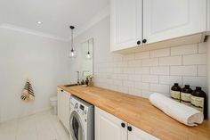 White laundry with wooden bench tops. House in Sydney Australia. - Ikea DIY - The best IKEA hacks all in one place Laundry Bathroom Combo, Downstairs Bathroom, Three Birds Renovations, Laundry Room Design, Laundry Rooms, Ikea Laundry, Laundry Cupboard, Small Laundry, Laundry Hamper