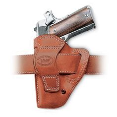 Galco AVENGER BELT HOLSTER GLOCK - 17 | Full combat grip accessibility allows an instant shooting grip, stitched sight rails prevent snags on the draw, the reinforced holster opening provides easy eyes-off re-holstering, while the vertical orientation allows the fastest, wrist-locked draw stroke. The tension screw allows for micro-adjustment of the draw stroke. The Avenger is made for semiautomatic pistols and is available in right or left hand designs, in tan or black.