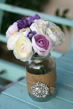off white, cream, ivory, and purple, violet, lavender ranunculus, anemones, and roses