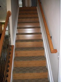 I like these steps and the metal rails on the railing. Wood steps are BEAUTIFUL, but I'm a klutz. And I have a boy who's an accident waiting to happen. Flooring Near Me, Flooring For Stairs, Carpet Treads, Carpet Stairs, Cantilever Stairs, Stair Railing, Stairway Wainscoting, Laminate Stairs, Stairs Canopy