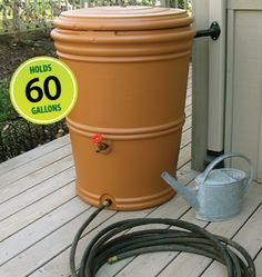 Aquabarrel Rainstation. Perfect to capture summer rains to water your garden.