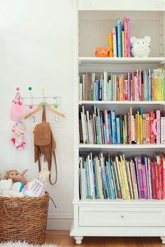 LOVE the shelf supports in this bookcase!  Touring The Wonderfully Whimsical Home Of Kate Brightbill | Glitter Guide