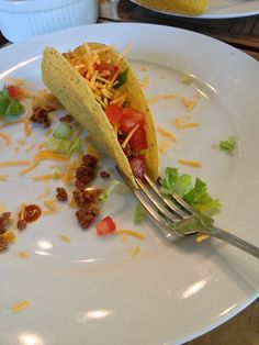 Make filling a taco easy by putting a fork under it like this: