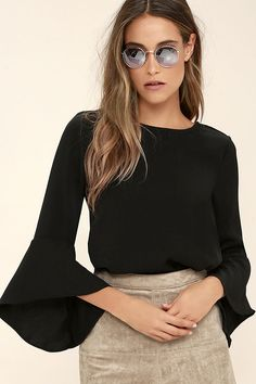 There is nothing quite like your favorite song and the Glamorous Ayo Black Long Sleeve Top to start the night right! Medium-weight woven knit shapes a rounded neckline, scoop back (with cross strap), and long, ruffled bell sleeves. Relaxed, wide-cut bodice.