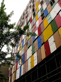South Korean Artist Choi Jeong-Hwa transforms a building in Seoul w/ a thousand reused doors.  I love this so much!