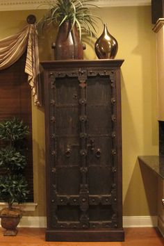 This old door Indian cabinet from Discoveries in the Baton Rouge home of Lisa Warm.  www.discoveriesLA.com