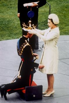 Queen Elizabeth II placing the Prince of Wales's crown onto Prince Charles in 1969