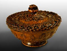 Wooden Mazer ca.1400 Probably France. A lidded drinking bowl carved out of a knot of maple wood with imitation Islamic decorative inscriptions.