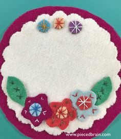 Super fast wool applique' project! Love the simple stitches, the primitive yet bright look of this coaster!