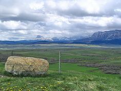 Ranch country in Southern Alberta foothills. That is the famous landmark, 'Big Chief Mountain' in the distance.