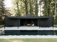 CD Poolhouse is a minimalist holiday home by Belgian designer Marc Merckx, featuring a black timber facade that sits comfortably in it's natural surrounds. Minimalist House Design, Minimalist Home, Outdoor Spaces, Outdoor Living, Modern Pool House, Tamizo Architects, Black Building, Moderne Pools, Pool House Designs