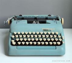 BABY BLUE SMITH CORONA SUPER MANUAL TYPEWRITER WITH STRIPES + CASE - SOLD