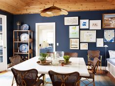 navy walls, plank pine ceiling, gallery wall, woven café chairs
