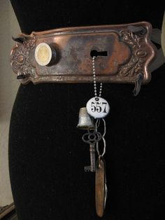 antique door plate as belt buckle with chatelaine created with key, thimble, pocketknife and hotel door key tag