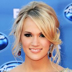 Carrie Underwood's updo's always have the best face-framing pieces. love this!