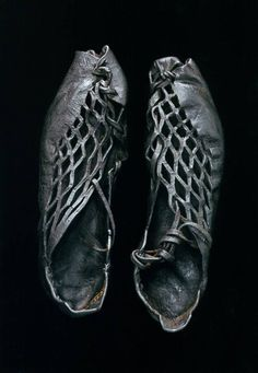 This pair of intricately cut shoes were found on a body discovered in a bog, they date back 2,300 years. I would love to wear them now ...2015...