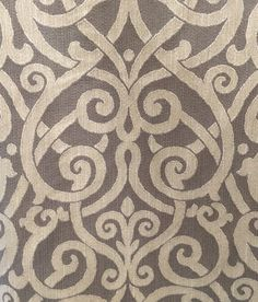 Grey and Cream Ironwork Upholstery Fabric  Details: -Content: 100% Cotton - Vertical Repeat: 29 - Horizontal Repeat: 28 - Width: 58.5 - Care: Dry